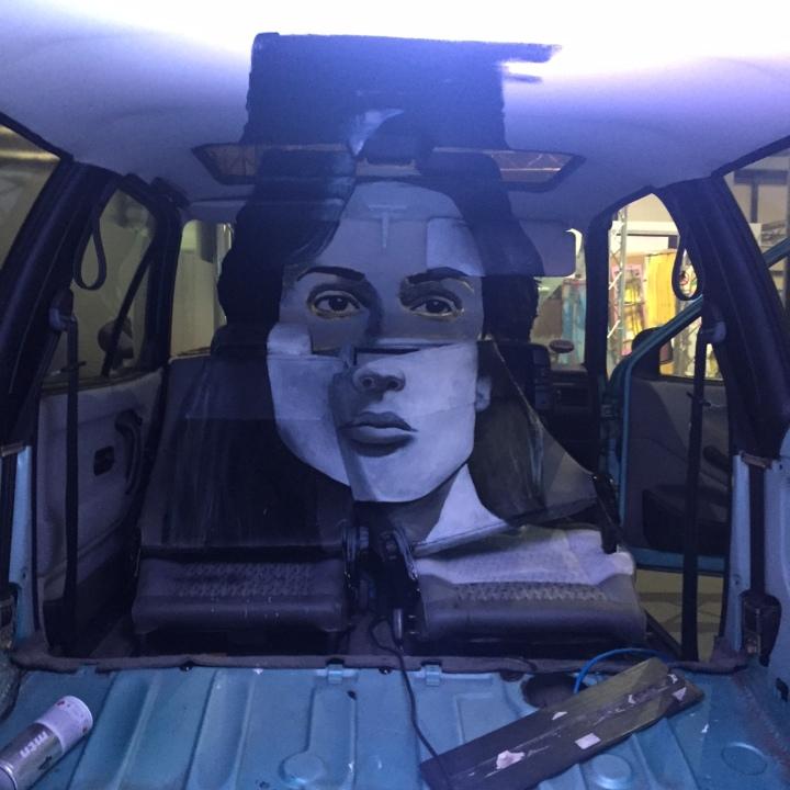 Car interior with a face